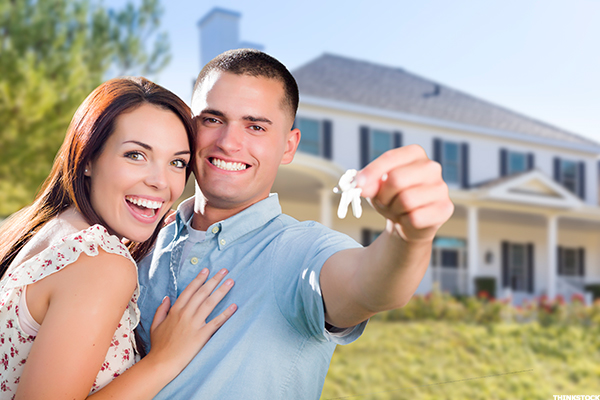 smiling couple holding house keys