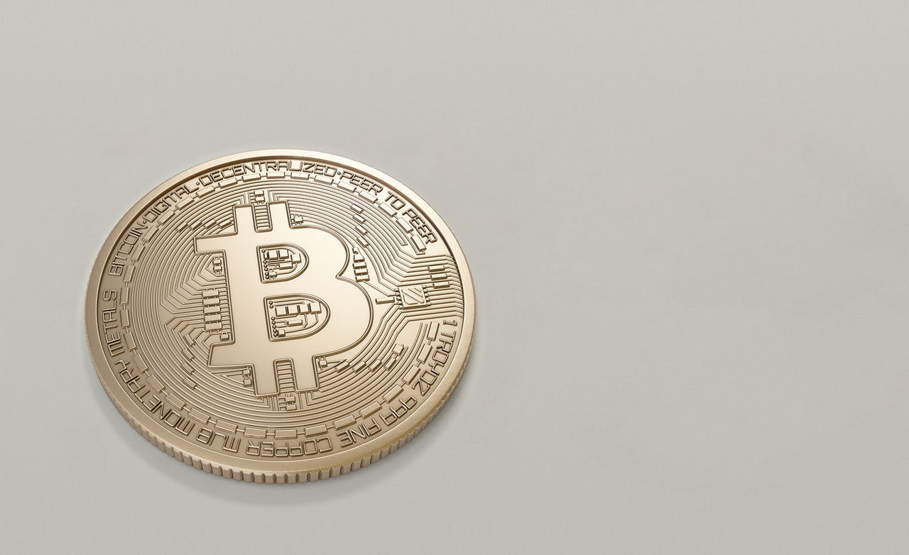 Gold bitcoin on grey background
