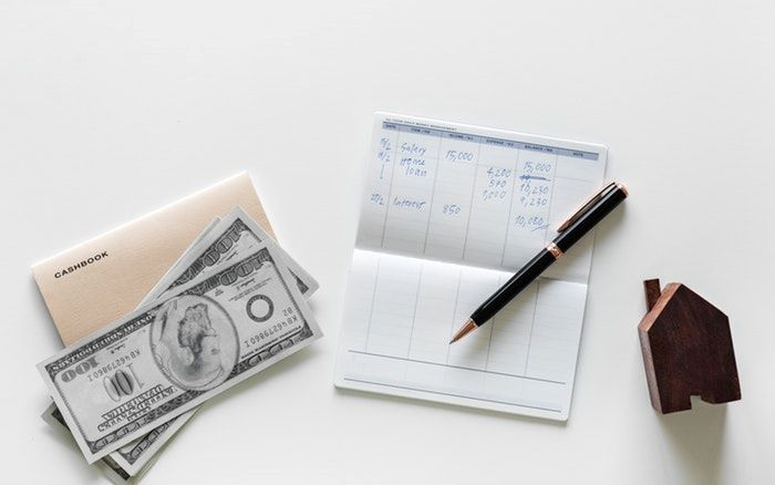 money-account book and pen in a white background